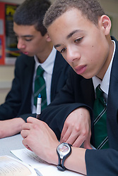 Secondary School student studying data and finding of experiments in Science lesson,