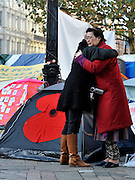 © Licensed to London News Pictures. 13/11/2011. London, UK. People hug after the two minute silence. Occupy London protest camp During the Remembrance Service held at St Paul's Cathedral in London today, 13th November 2011. Photo credit : Stephen Simpson/LNP