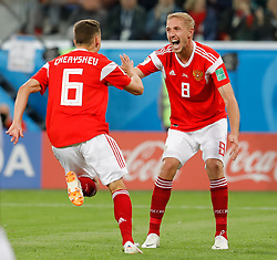 June 19, 2018 - Saint Petersburg, Russia - Denis Cheryshev (L) of Russia national team celebrates his goal with Yury Gazinsky during the 2018 FIFA World Cup Russia group A match between Russia and Egypt on June 19, 2018 at Saint Petersburg Stadium in Saint Petersburg, Russia. (Credit Image: © Mike Kireev/NurPhoto via ZUMA Press)