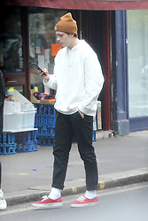 EXCLUSIVE ALL ROUNDER Fashion photographer Brooklyn Beckham turned in to a model today as he posed for a picture taken by a pal on his phone. Beckham, 18, was dressed down in in a hoodie and beanie hat following his red carpet appearance last night with dad David at the King Arthur fiLm premiere.<br /><br />11 May 2017.<br /><br />Please byline: Vantagenews.com