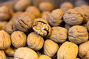 Walnuts kernel in shells in the Misir Carsisi Egyptian Bazaar food and spice market in Istanbul, Turkey