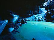 Ice floe within Bandera Ice Cave, lava tube near Bandera Crater, El Malpais National Monument, New Mexico.