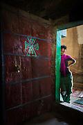 Young boy at the inner entrance to Medhane Alem Adi Kesho Church, Adi Kesho, Tigray region. Ethiopia, Horn of Africa