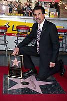 4/29/2011 Joe Mantegna poses by his Hollywood Walk of Fame star