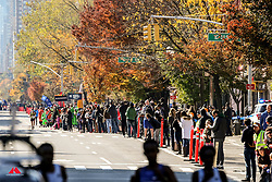 spectators line race course and cheer elite women as they pass<br /> TCS New York City Marathon 2019