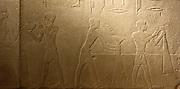 Tomb relief: Men harvesting in the presence of Hetepet (left) 6th dynasty 2360-2195 BC.