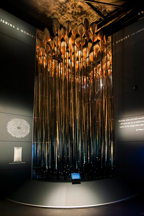 Heatherwick's London 2012 Cauldron goes on display in a purpose built Museum of London gallery - The Cauldron, designed by the Heatherwick Studio, for the London 2012 Olympic Games included 204 unique copper elements, each alight and representing every competing nation. They were arranged in a concentric formation at the tips of slender mechanised steel stems. Slowly pivoting sequentially, they converged to form the Cauldron.<br />  <br /> In the courtyard of the museum, a bespoke new pavilion has been specially built by Stage One - the creative engineers behind the London 2012 Cauldron. The exhibition has been designed by the creative consultants, Drinkall Dean. On show are two sections of the Cauldron – including the original steel stems and test versions of the copper elements.  One section presents the Cauldron in an upright position, as it was for the majority of both Games. The other is the Cauldron in an open formation, as if frozen at that climactic defining moment of the opening Olympic ceremony. The room pens Friday 25 July 2014.