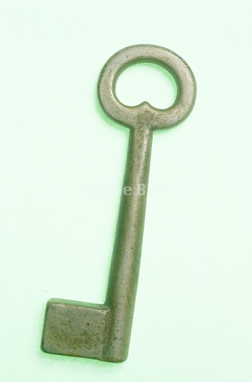 Still life of a key with green shadow