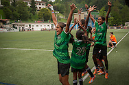 Yuwa team players at the benches celebrate they scored against Añorga team. Donostia-San Sebastian (Basque Country) 02 July 2013. Yuwa Jharkhand is a program for girls aged 5-17 to promote health, education and improved livelihoods through football. Yuwa team was in Donostia playing Donosti Cup international football tournament (Gari Garaialde/Bostok Photo)