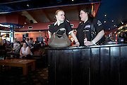 Ladies darts champions Anastasia Dobromyslova and fellow Russian friend Irena Armstrong await their next game