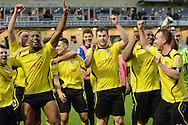 Chesham players celebrate the win during the The FA Cup match between Bristol Rovers and Chesham FC at the Memorial Stadium, Bristol, England on 8 November 2015. Photo by Alan Franklin.