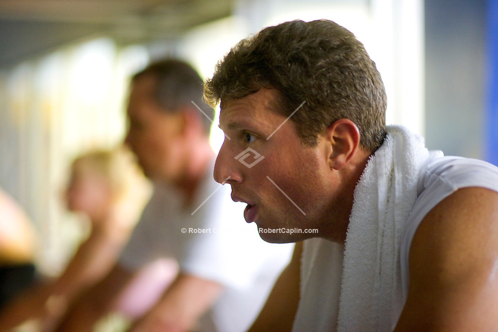 Eric Haims during a spin class at New York Sprots Club, May 29, 2008. Photographer: Robert Caplin For The New York TImes..