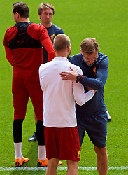 LIVERPOOL, ENGLAND - Monday, May 21, 2018: Liverpool's manager Jürgen Klopp embraces Ragnar Klavan during a training session at Anfield ahead of the UEFA Champions League Final match between Real Madrid CF and Liverpool FC. (Pic by Paul Greenwood/Propaganda)