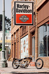 Arlen Ness' custom Harley-Davidson known as Nesstique in front of Bob Dron's first Harley-Davidson store in Oakland, CA. Photograph ©Michael Lichter 1987
