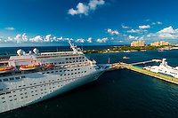 Carnival Fantasy cruise shipw with the Atlantis Paradise Island resort in background, Nassau, The Bahamas