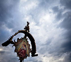 02.05.2011, Kaprun, AUT, FEATURE RELIGION, im Bild ein Kreuz mit dem Abbild der Heiligen Mutter Maria und dem Jesu Kind am Kirchbichl Kaprun, am Himmel ziehen Regenwolken auf, düstere Stimmung // a cross with the image of the Holy Mother Mary and baby Jesus on Kirchbichl Kaprun, the sky to attract rain clouds, gloom, EXPA Pictures © 2011, PhotoCredit: EXPA/ J. Feichter