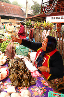 The Luang Prabang Morning Market is a batch of outdoor stalls selling pretty much everything starting up at sunrise and remaining open till 12:00 noon.