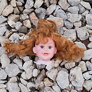 The head of a doll lies on the track ballast in Idomeni railway station. <br /> <br /> Thousands of refugees are stranded in Idomeni unable to cross the border. The facilities are stretched to the limit and the conditions are appalling