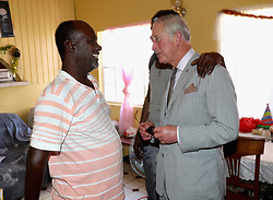 The Prince of Wales meets displaced Barbudans during a visit to the Holy Trinity School n Codrington, Barbuda, as he continues his tour of hurricane-ravaged Caribbean islands.