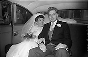 """16/09/1967<br /> 09/16/1967<br /> 16 September 1967<br /> Wedding of Mr Francis W. Moloney, 28 The Stiles Road, Clontarf and Ms Antoinette O'Carroll, """"Melrose"""", Leinster Road, Rathmines at Our Lady of Refuge Church, Rathmines, with reception in Colamore Hotel, Coliemore Road, Dalkey. Image shows the Bride and Groom in the car after the ceremony."""