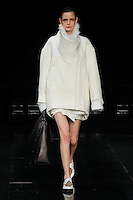 A model walks the runway wearing Helmut Lang Fall 2014 in New York on February 7th, 2014
