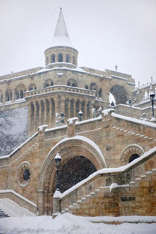 Fisherman's Bastion in the winter snow. Castle district Budapest stock photos .<br /> <br /> Visit our HUNGARY HISTORIC PLACES PHOTO COLLECTIONS for more photos to download or buy as wall art prints https://funkystock.photoshelter.com/gallery-collection/Pictures-Images-of-Hungary-Photos-of-Hungarian-Historic-Landmark-Sites/C0000Te8AnPgxjRg