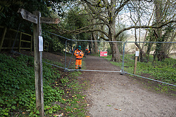 Denham, UK. 6th April, 2021. A HS2 notice indicates the closure of an area of Denham Country Park for electricity pylon relocation works connected to the HS2 high-speed rail link. Thousands of trees have already been felled in the Colne Valley where HS2 works will include the construction of a Colne Valley Viaduct across lakes and waterways and electricity pylon relocation.