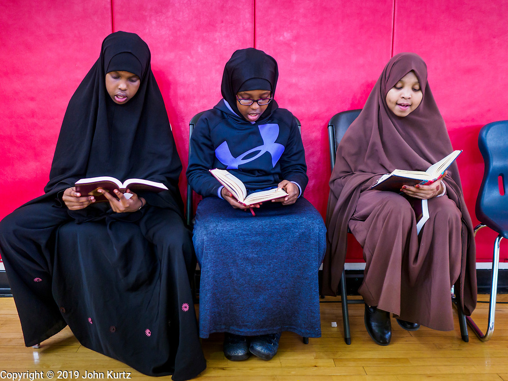 16 MARCH 2019 - BLOOMINGTON, MINNESOTA, USA: Girls read their Korans at Dar al Farooq Center in Bloomington. An interdenominational crowd of about 1,000 people came to the center to protest white supremacy and religious intolerance and to support Muslims in New Zealand who were massacred by a white supremacist Friday. The Twin Cities has a large Muslim community following decades of Somali immigration to Minnesota. There are about 45,000 people of Somali descent in the Twin Cities.   PHOTO BY JACK KURTZ
