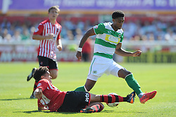 Yeovil Town's Sean Jeffers is tackled by Exeter City's Troy Brown - Photo mandatory by-line: Harry Trump/JMP - Mobile: 07966 386802 - 08/08/15 - SPORT - FOOTBALL - Sky Bet League Two - Exeter City v Yeovil Town - St James Park, Exeter, England.