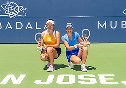 August 5, 2018 - San Jose, CA, U.S. - SAN JOSE, CA - AUGUST 05: Kveta Peschke (CZE) and Latisha Chan (TPE) celebrates with their trophies on the court of the WTA Doubles Championship match at the Mubadala Silicon Valley Classic on the San Jose State University Stadium Court in San Jose, CA  on Sunday, August 5, 2018. (Photo by Douglas Stringer/Icon Sportswire) (Credit Image: © Douglas Stringer/Icon SMI via ZUMA Press)