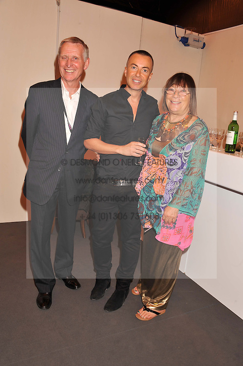 Left to right, TERRY MANSFIELD, JULIEN MACDONALD and HILARY ALEXANDER at the Graduate Fashion Week Gala drinks reception held at Earls Court 2, London on 13th June 2012.