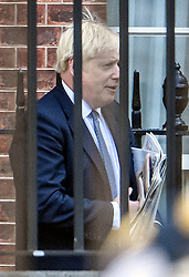 © Licensed to London News Pictures. 19/09/2019. London, UK. British Prime Minister BORIS JOHNSON is seen leaving Downing Street via a back exit. The Supreme Court is currently hearing evidence from former Prime Minster John Major at day three of an appeal against a ruling on the proroguing of parliament. Photo credit: Ben Cawthra/LNP