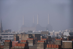 © London News Pictures. 05/09/2013. London, UK.  The towers of the old Battersea power station is seen over roof tops in London shrouded in mist early morning in London on September 05, 2013. Photo credit: Ben Cawthra/LNP