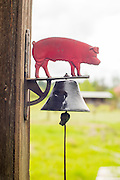 The bell that hangs out front of the shop at Red Pig Tools