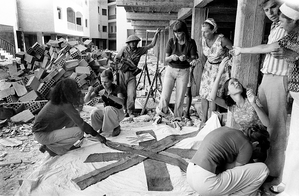 Cyprus War 20 July–18 August 1974. Turkish invasion of Cyprus code-name by Turkey, Operation Attila. British and German tourists make a Union Jack flag to alert Royal Many rescue helicopters flying inland to rescue them.  at the northern Cyprus town of Kyrenia shortly after the invasion July 1974. Photo by Terry Fincher.