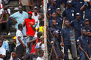 After quelling the situation in the stands, members of the National Police remain as a buffer between hooligans.