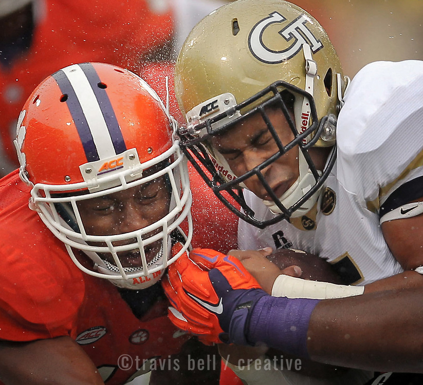 Clemson Tigers player Travis Blanks and Georgia Tech quarterback Justin Thomas collide helmet-to-helmet in the rain during an ACC college football game in Clemson.©Travis Bell Photography