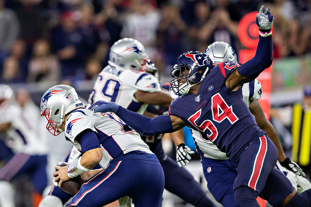 HOUSTON, TX - DECEMBER 1:  Jacob Martin #54 of the Houston Texans sacks Tom Brady #12 of the New England Patriots during the first half at NRG Stadium on December 1, 2019 in Houston, Texas.   (Photo by Wesley Hitt/Getty Images) *** Local Caption *** Jacob Martin; Tom Brady