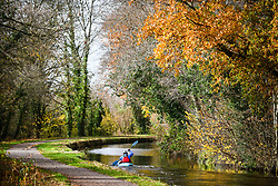© Licensed to London News Pictures. 17/11/2020. Brecon, UK. Kayaker, Nick Durham makes his way along the Monmouthshire and Brecon Canal in Brecon, Wales on a typical Autumn day as blustery and wet weather grips the UK and is forecast to remain throughout the week. Photo credit: Robert Melen/LNP