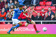 Lewis Morgan of Sunderland (17) and Nathan Thompson of Portsmouth (20) during the EFL Sky Bet League 1 first leg Play Off match between Sunderland and Portsmouth at the Stadium Of Light, Sunderland, England on 11 May 2019.