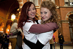 © Licensed to London News Pictures. 19/01/2012. London, U.K. Emily Brown and Rose Manley take part in  world's Longest marathon hug attempt at St. Pancras station, London on January 19th, 2012. Competitors are attempting to break the Guinness World Record for the world's Longest hug. Photo credit : Rich Bowen/