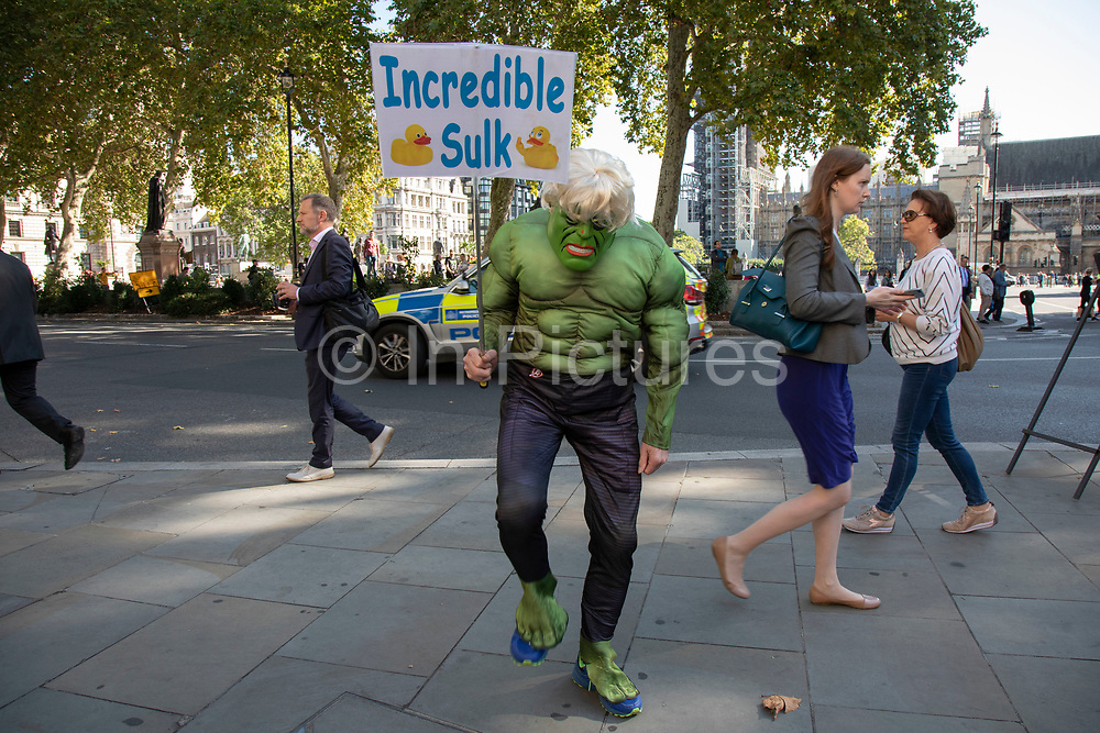 Protester dressed up as the Incredible Hulk with his 'Incredible Sulk' placard in reference to Boris Johnson's recent comment 'The madder Hulk gets, the stronger Hulk gets.' outside The Supreme Court as the first day of the hearing to rule on the legality of suspending or proroguing Parliament begins on September 17th 2019 in London, United Kingdom. The ruling will be made by 11 judges in the coming days to determine if the action of Prime Minister Boris Johnson to suspend parliament and his advice to do so given to the Queen was unlawful. (photo by Mike Kemp/In Pictures via Getty Images)