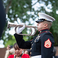 Staff sergeant David Villanueva plays taps following the funeral Mass for state Sen. John Pinto, May 30 at Sacred Heart Cathedral in Gallup.