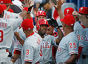 Phillies shortstop Jimmy Rollins gets congratulated after scoring the first run of the game during the game between the Atlanta Braves and the Philadelphia Phillies at Turner Field in Atlanta, GA on May 25, 2007..