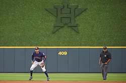 March 26, 2018 - Houston, TX, U.S. - HOUSTON, TX - MARCH 26: Houston Astros infielder Carlos Correa (1) shifts behind second to defend against a left handed hitter during the game between the Milwaukee Brewers and Houston Astros at Minute Maid Park on March 26, 2018 in Houston, Texas. (Photo by Ken Murray/Icon Sportswire) (Credit Image: © Ken Murray/Icon SMI via ZUMA Press)