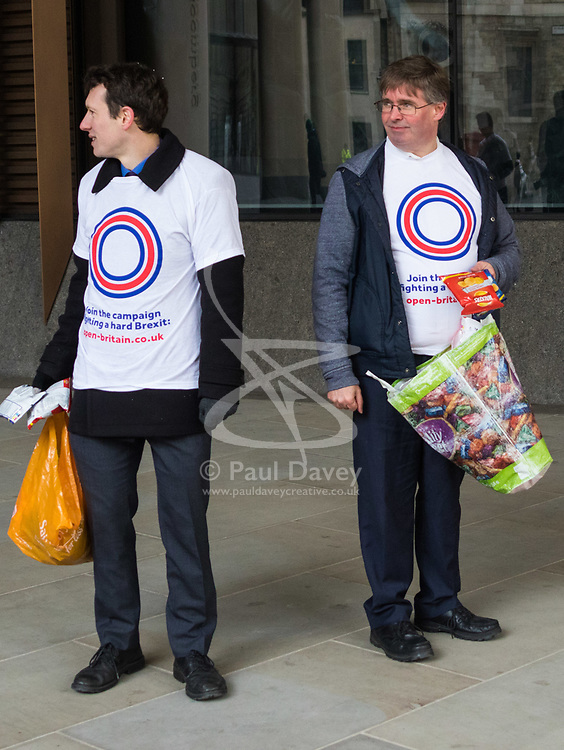 A small group of activists from ant-Brexit group Open Britain hands out crisps to the public outside Bloomberg's European Headquarters in London ahead of a speech by International Trade Secretary Liam Fox on Britain's future as a global trading nation. London, February 27 2018.