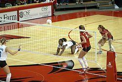20 November 2004....Paige White goes to the wood for a dig....Illinois State University Redbirds V Drake Bulldogs Women's Volleyball.  Redbird Arena, Illinois State University, Normal IL