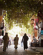 People shop in a souq of the Old City in Damascus, Syria