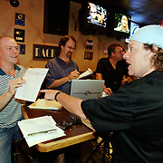 LAS VEGAS, NEVADA, August 19, 2007: Professional Poker players Gavin Smith, in hat, and Eric Lindgren, left,  were in Las Vegas, Nevada on August 19, 2007 to participate in a fantasy football league whereby participants purchase players at a draft auction and then track the  performance of those players throughout the year and accumulate points.