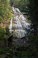 A view through the forest to Bridal Veil Falls at Bridal Veil Falls Provincial Park in Chilliwack, British Columbia, Canada